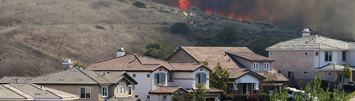 Fire approaching homes photo